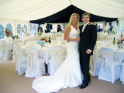 Wedding couple and marquee